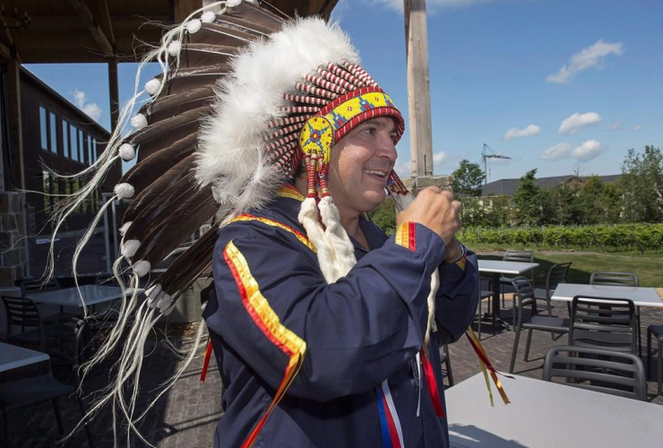 Perry Bellegarde, National Chief of the Assembly of First Nations, headdress, Atlantic MP, First Nations chiefs in Wolfville.