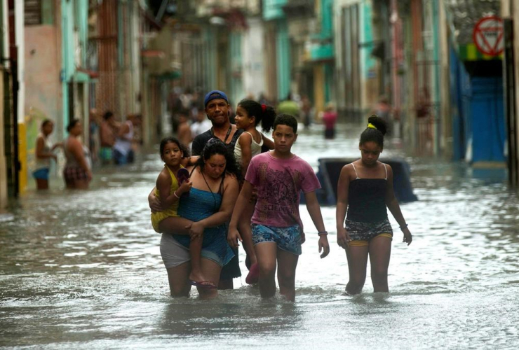 People, walk, flooded streets, Havana, Hurricane Irma, Cuba,