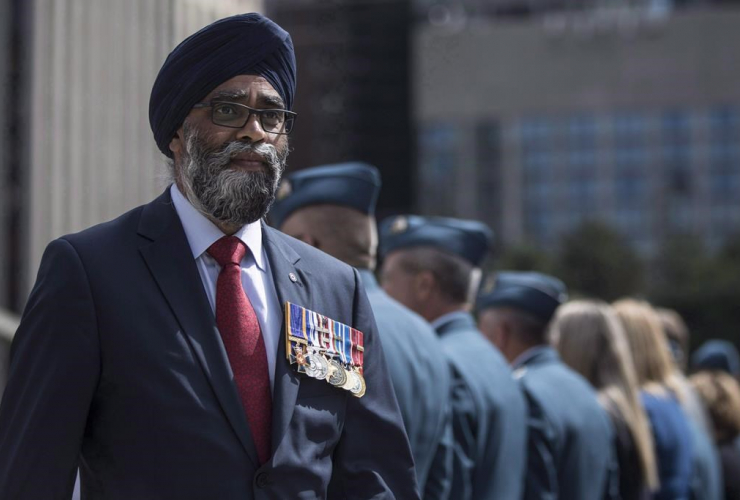 Defence Minister Harjit Sajjan, service medals, Royal Canadian Air Force, ceremonial flags,