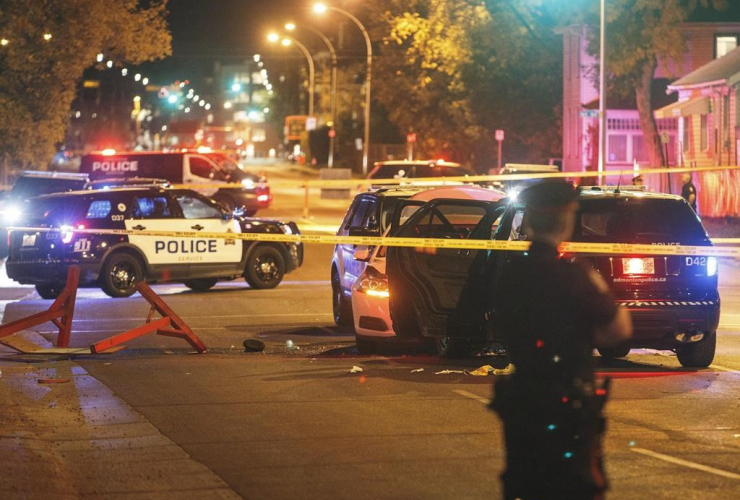 Police, investigate, scene, car, crashed, Edmonton,