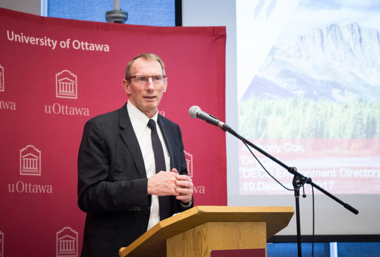Anthony Cox, the OECD's environment director, during a press conference at the University of Ottawa.
