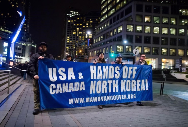 Protesters, banner, marching, summit, North Korea, Canada, U.S., Vancouver,
