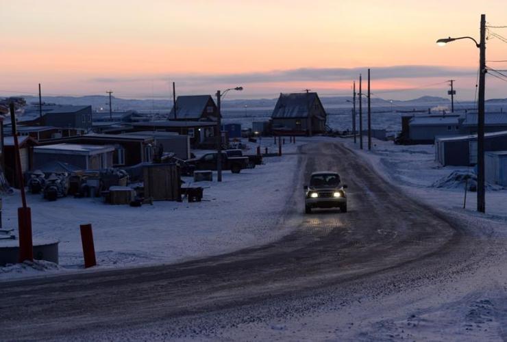 sun rises, car, road, Iqaluit, Nunavut,