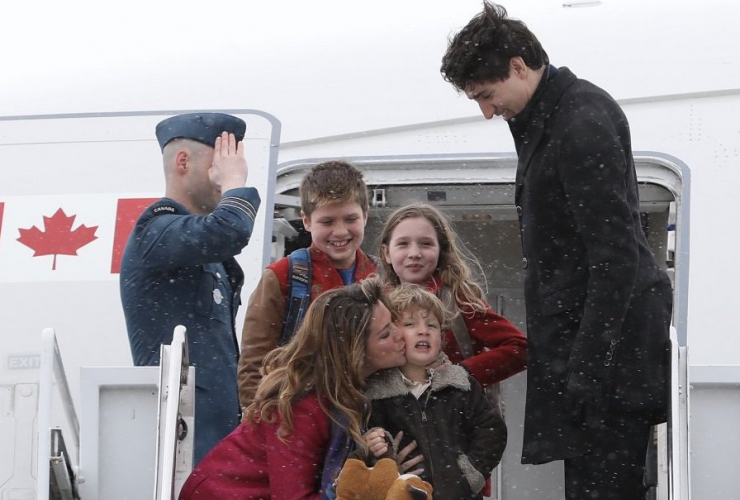 Prime Minister Justin Trudeau, Sophie Grégoire-Trudeau and their children board a plane in Ottawa headed on a trade mission in India on Feb. 16, 2018. PMO photo