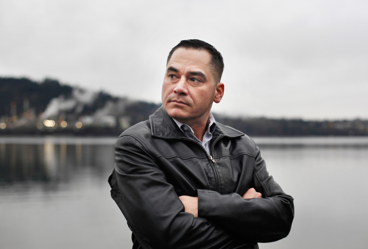 Tsleil-Waututh member Will George stands on the shores of the Burrard Inlet in Burnaby, B.C. on Feb. 7, 2018, near the terminal for Kinder Morgan's Trans Mountain pipeline. Photo by Jennifer Osborne