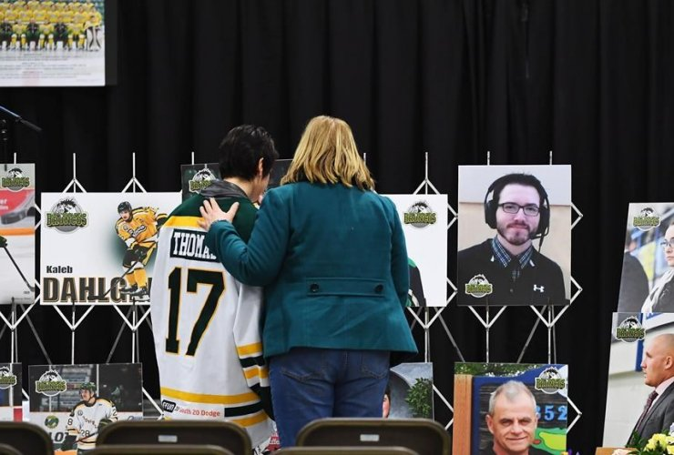 Mourners, photographs, vigil, Elgar Petersen Arena, Humboldt Broncos, bus accident,