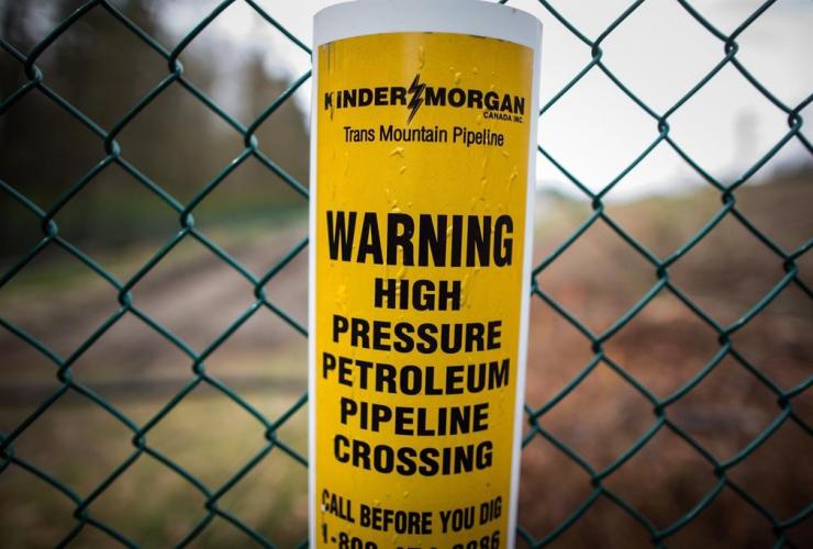 sign warning, underground petroleum pipeline, Kinder Morgan, Trans Mountain Pipeline, Burnaby,
