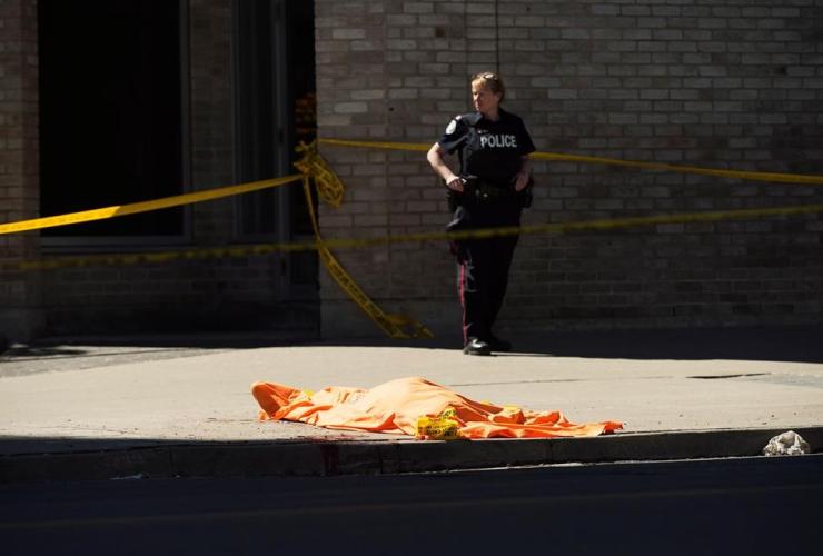 police officer, covered body, Toronto, van, sidewalk, pedestrians,