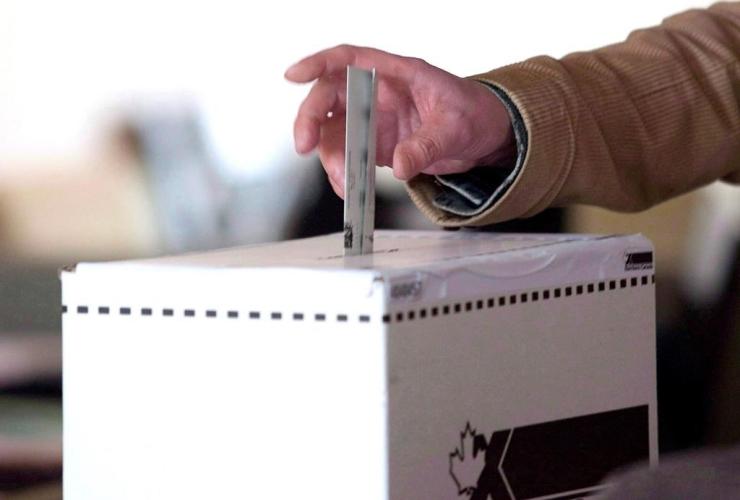man, casts, vote, federal election, Toronto,