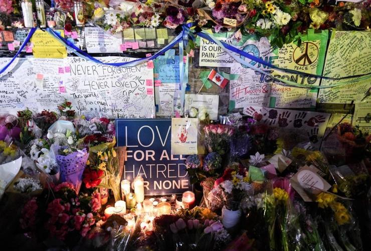 Flowers, notes, candles, vigil, Yonge Street, Toronto,
