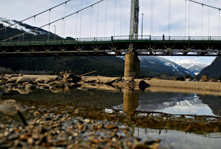 man, crosses, bridge, Columbia River, Revelstoke,