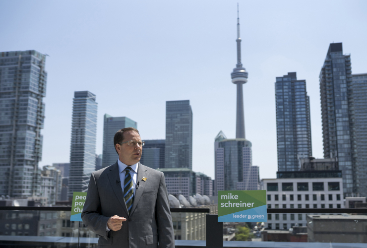 Mike Schreiner, leader of the Green Party of Ontario, speaks to reporters on a Toronto rooftop on May 24, 2018. Photo by Nick Iwanyshyn