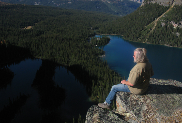 John Lefebvre sitting near the border of BC and Alberta overlooking Lake Ohara