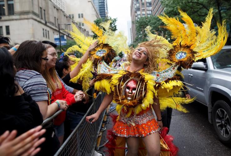 reveller dances, parade, Toronto Pride parade,