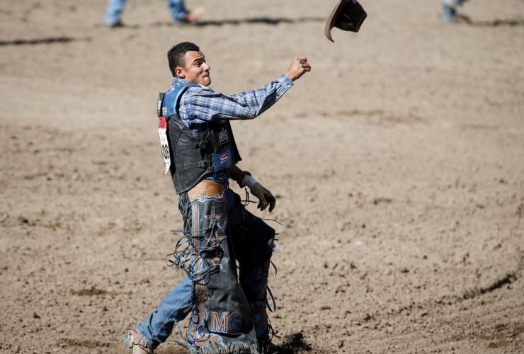 Marcos Gloria, Edmonton, Alberta, Bull Riding event, rodeo action, Calgary Stampede, Calgary,