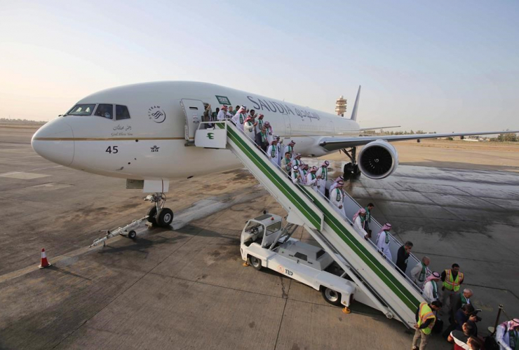 Passengers, disembark, plane, Saudia airline, Baghdad International Airport, Iraq,
