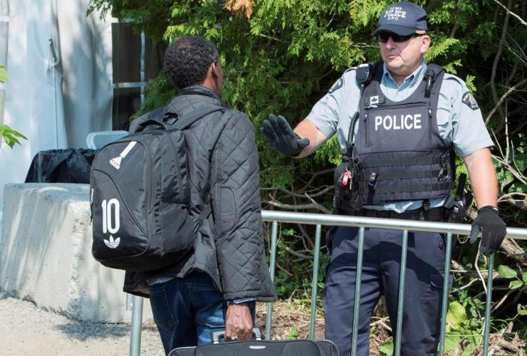 asylum seekers, Eritrea, RCMP officer,