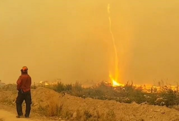 "In the video posted to Instagram by firefighter Mary Schidlowsky, three crew members can be seen in a tug of war against what she calls a ""fire tornado,"" which is sucking a hose skyward like a kite string."