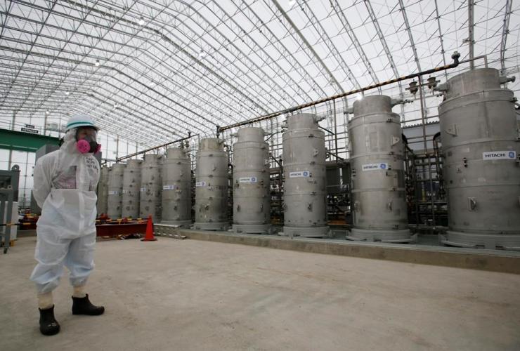 TEPCO official, radioactive protective gear, Advanced Liquid Processing Systems, Fukushima Dai-ichi nuclear power plant, Okuma,
