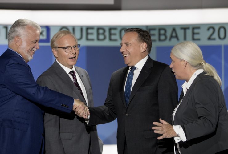 Philippe Couillard, Jean-François Lisée, François Legault, Manon Masé shake hands at the election debate held on 17 Sept. 2018, Photo courtesy of Allen McInnes