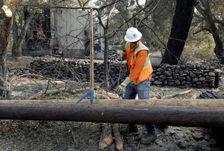 Pacific Gas & Electric worker, power poles, wildfires, Glen Ellen, Calif.,