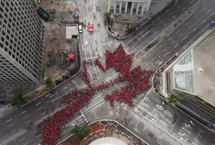 Winnipeggers, Canada, 150th birthday, Living Leaf, downtown intersection, Portage, Main,