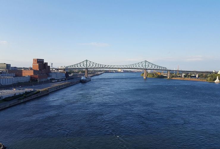 Look over the Saint Lawrence River with the Jacques-Cartier bridge from the Montreal clock tower.