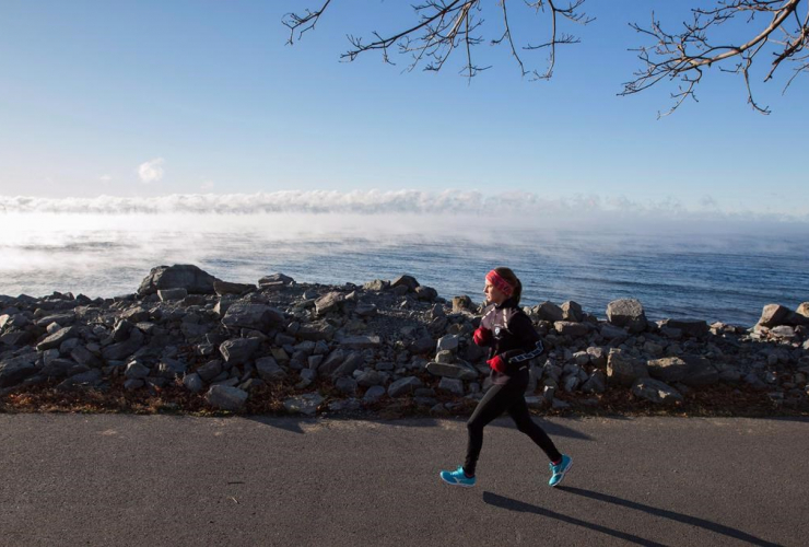woman, runs, Lake Ontario, cold mist,