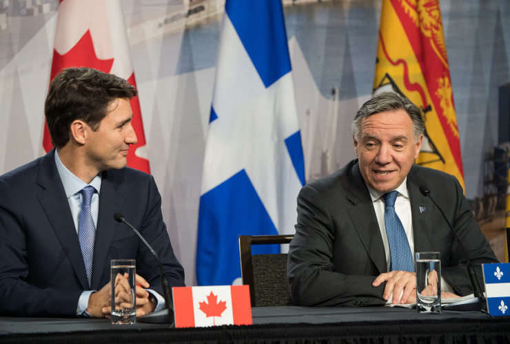 Prime Minister Justin Trudeau and Quebec Premier François Legault speak during the First Ministers' Meeting in Montreal on Dec. 7, 2018. Photo by Josie Desmarais