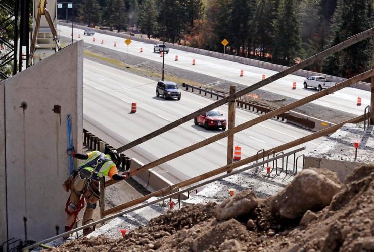 worker, panels, wildlife bridge, Snoqualmie Pass,