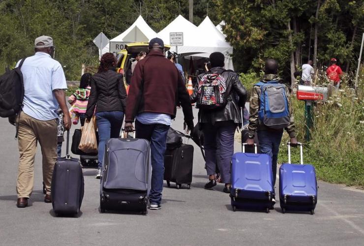 family, Haiti, Saint-Bernard-de-Lacolle, Quebec, Royal Canadian Mounted Police, luggage, Roxham Road, Champlain,