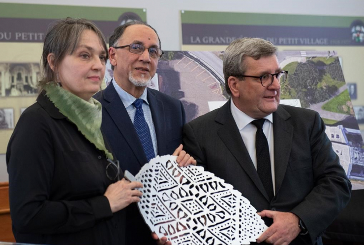 Luce Pelletier, Boufeldja Benabdallah and Regis Labeaume hold one of the six metal leafs representing one of the six victims of the 2017 Mosque shooting, on Jan. 29, 2019 in Quebec City. Photo by The Canadian Press/Jacques Boissinot