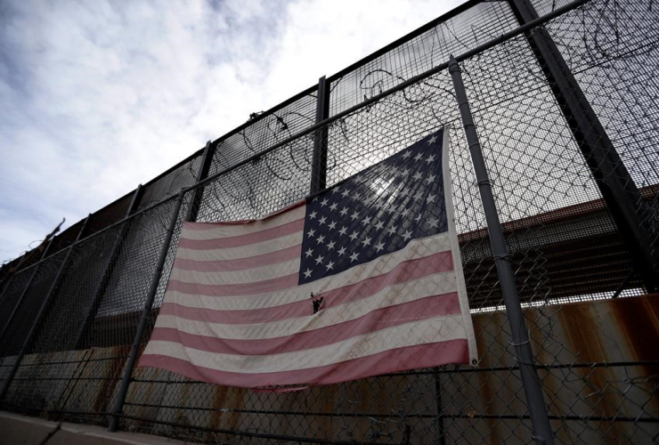 U.S. flag, border barrier, El Paso, Texas,