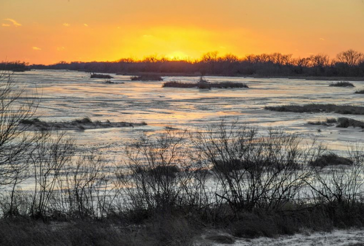 sun sets, ice-covered, Platte River, Columbus,