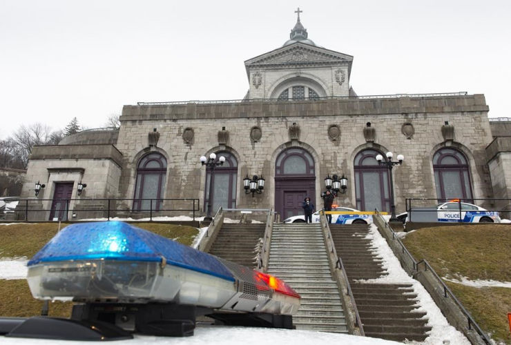 Police cars surround the St. Joesph's Oratory in Montreal on Friday, March 22, 2019. A Catholic priest was stabbed as he was celebrating mass this morning at the Oratory.