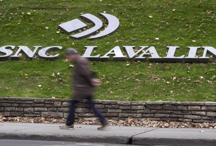 man, walks, headquarters, SNC-Lavalin, Montreal,