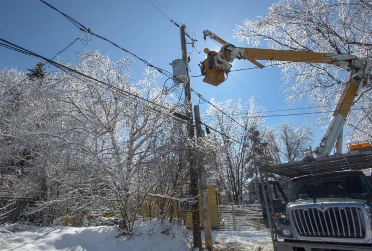Hydro Quebec workers, repair, power lines, Laval, Que., ice storm,