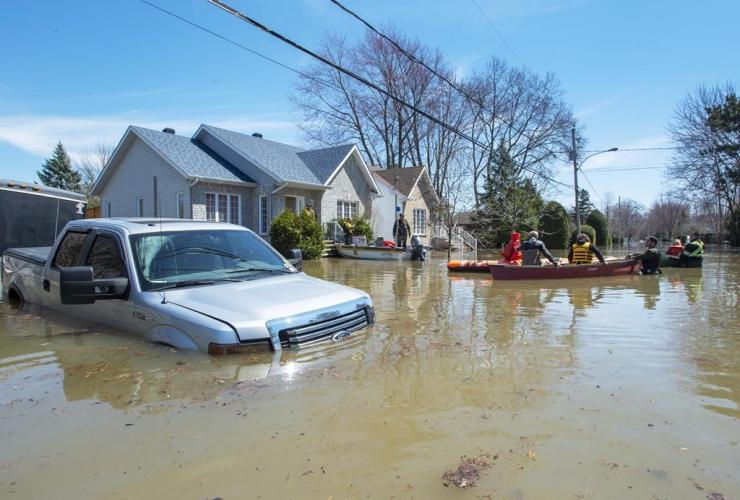 Quebec Provincial Police, evacuees, flooded homes, Ste.Marthe-sur-la-Lac,