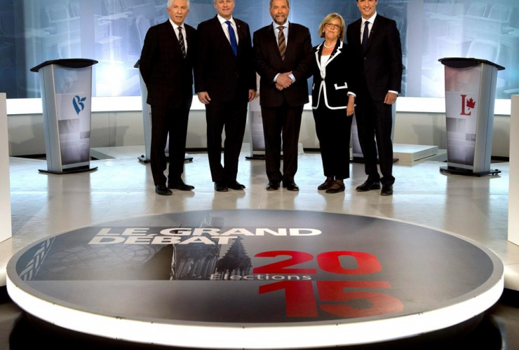 Gilles Duceppe, from left to right, Stephen Harper, Tom Mulcair, Elizabeth May and Justin Trudeau pose for photos before the French-language leaders' debate in Montreal on September 24, 2015. File photo by The Canadian Press/Adrian Wyld