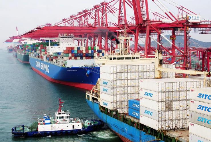 barge, container ship, dockyard. Qingdao, China, Shandong province,