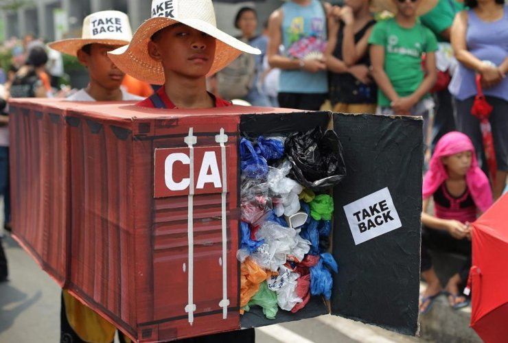 Filipino environmental activists, wear, mock shipping container, garbage, protest, Canadian embassy, Makati,