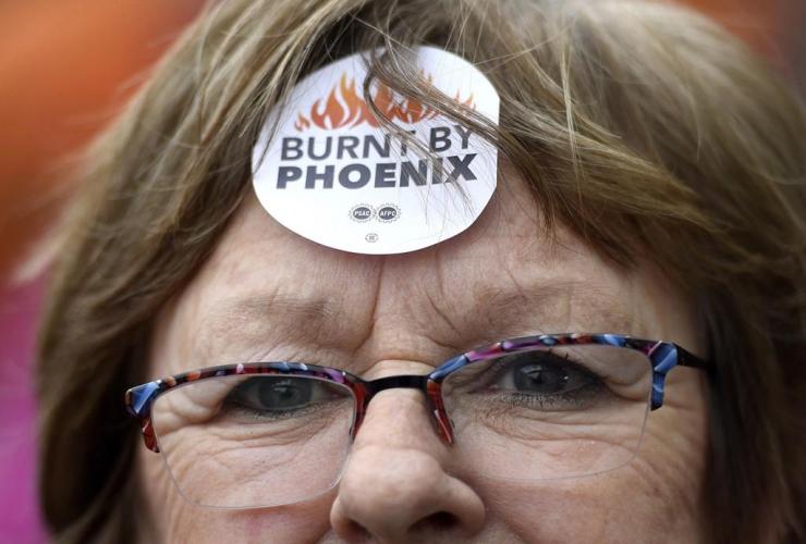 Shirley Taylor, Burnt by Phoenix, sticker, forehead, rally, Phoenix payroll system,
