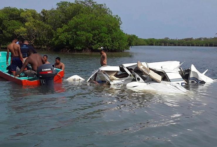 Honduras Fire Department, firefighters, crash site, plane, Atlantic in Roatan, Bay Island, Honduras,