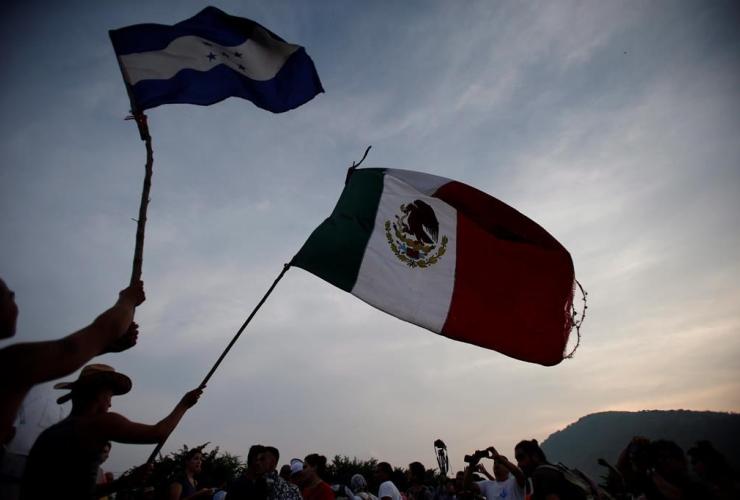Migrants, wave, flags, Honduras, Mexico,