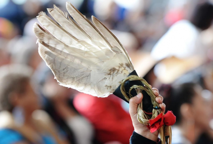 person, holds, eagle feather, closing ceremony, National Inquiry into Missing and Murdered Indigenous Women and Girls, Gatineau, Que.,
