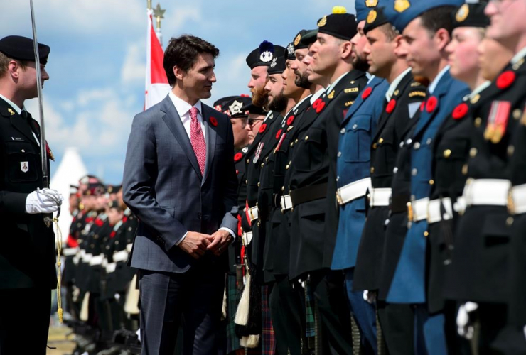 Prime Minister Justin Trudeau, inspects, honour guard, D-Day 75th Anniversary Canadian National Commemorative Ceremony, Juno Beach, Courseulles-Sur-Mer, France,