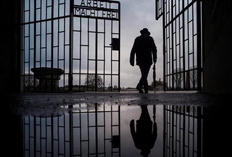 man, Sachsenhausen, Nazi death camp, Arbeit macht frei, work sets you free, International Holocaust Remembrance Day, Oranienburg, Germany,