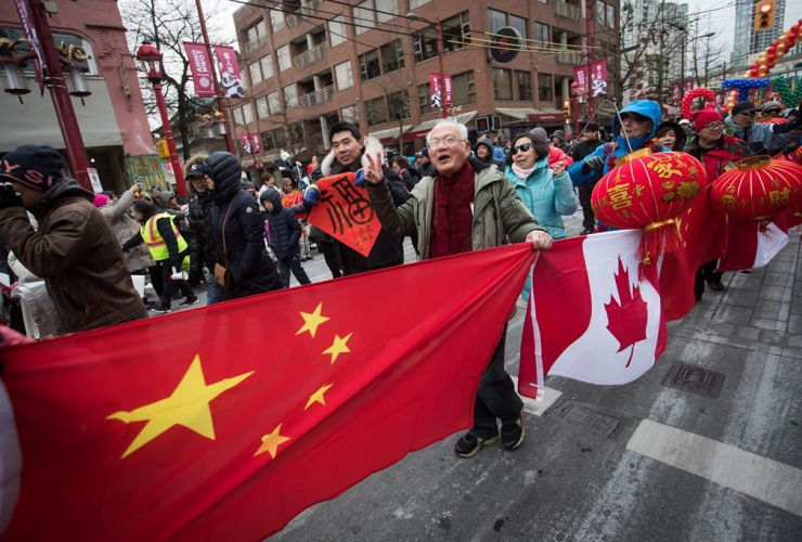 People, Chinese and Canadian flags, marching, Chinese New Year Parade, Vancouver,