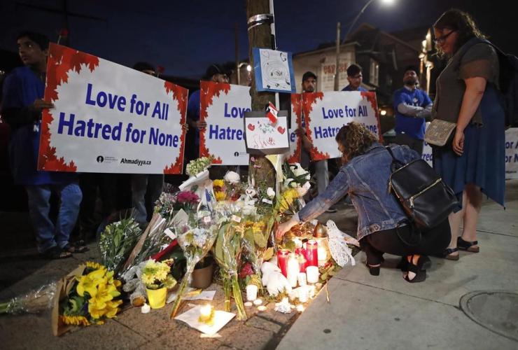 People, flowers, candles, memorial, victims, shooting, Danforth,