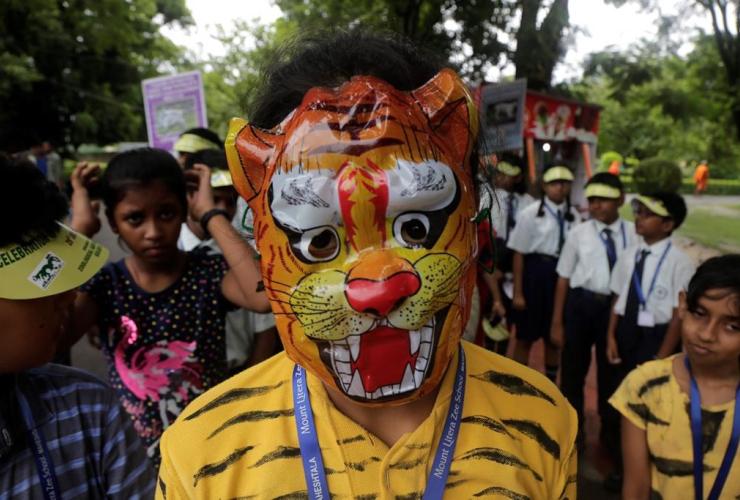 School children, tiger masks, awareness rally, International Tiger Day, Alipore zoo, Kolkata, India,